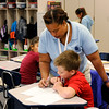 Don Knight | The Herald Bulletin<br /> Terasha Webb checks Gabe Ballinger's work during success period at Anderson Elementary on Thursday. Anderson Community Schools have reduced standardized testing seat time so teachers like Webb can spend more time on instruction.