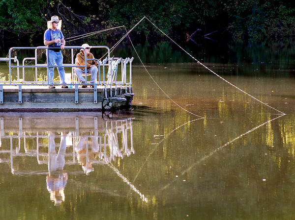John P. Cleary   The Herald Bulletin <br /> With calm waters at Shadyside Lake these fishermen cast a good reflection in the setting sun Monday evening as they enjoy the late summer weather.