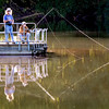 John P. Cleary | The Herald Bulletin <br /> With calm waters at Shadyside Lake these fishermen cast a good reflection in the setting sun Monday evening as they enjoy the late summer weather.