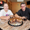 John P. Cleary | The Herald Bulletin_MAD<br /> Heaven's Delight Bakery & Cafe owners Kimberly and Chuck Whitaker in their new cafe located at 1309 Park Road with their coffee and turtle cheesecake.