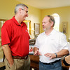 Don Knight | The Herald Bulletin<br /> G ubernatorial candidate Eric Holcomb talks to Pete Heuer during a GOP event at the home of Stephanie and Bryce Owens on Saturday.