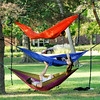 Don Knight | The Herald Bulletin<br /> From top to bottom, Ethan Sayles, Katie Ruth and Micah Zik relax in hammocks after a day of classes at Anderson University on Wednesday.