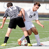 Don Knight | The Herald Bulletin<br /> Anderson's Alexander Fricke battles Hauser's Evan Shaw for control of the ball at Anderson University on Saturday.