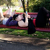 Don Knight | The Herald Bulletin<br /> Jacob Ritchie and Phoebe Mangas  lay on a park bench while playing Pokémon GO at Shadyside Park on Thursday.