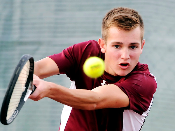 John P. Cleary   The Herald Bulletin<br /> Alexandria's #1 singles Matthew Hensley follows the ball after his shot during the first round of sectional play against AHS.  Hensley won his match 2-0.
