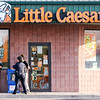 Don Knight | The Herald Bulletin<br /> APD investigates shots fired outside the Little Caesars on 38th Street on Tuesday.