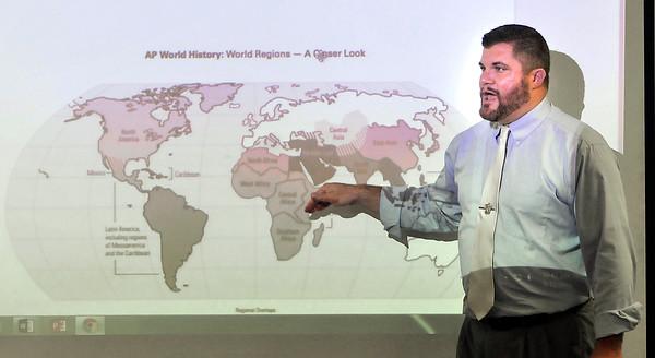 John P. Cleary   The Herald Bulletin<br /> Frankton Jr.-Sr. High School history teacher Kevin Cline uses the world map as he teaches his world history class.