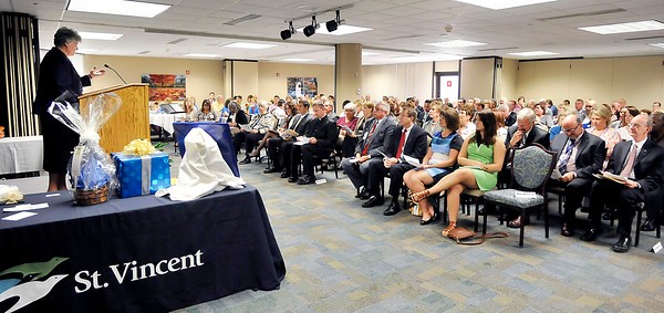 John P. Cleary | The Herald Bulletin <br /> Sister Eileen Wrobleski, C.S.C. Vice President Mission Integration St. Vincent Northeast Region, welcomes the large turnout for the commissioning of Mike Schroyer as Regional President of St. Vincent Northeast Region Monday.
