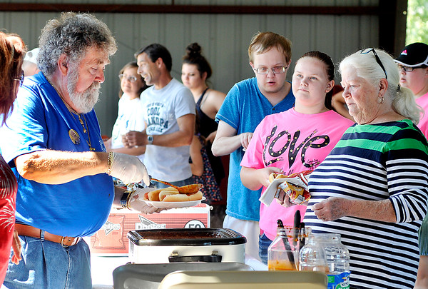 John P. Cleary | The Herald Bulletin<br /> Denny Cheshier dishes up the coney sauce for hungry picnic goers during the annual Madison County Solidarity Labor Council Labor Day picnic at Beulah Park in Alexandria Monday.