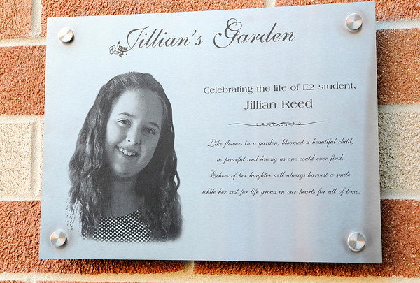 Don Knight | The Herald Bulletin<br /> Jillian Reed's photo is included on a plaque marking the courtyard garden planted in her memory and dedicated at Eastside Elementary on Thursday.
