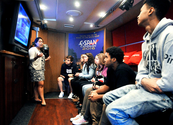 John P. Cleary | The Herald Bulletin<br /> C-Span marketing specialist Vanessa Torres explains to these Anderson High School seniors the purpose and inter-working of C-Span's 45-foot customized bus with it's mobile TV studio to it's interactive multimedia exhibits during their visit to the school Monday morning.