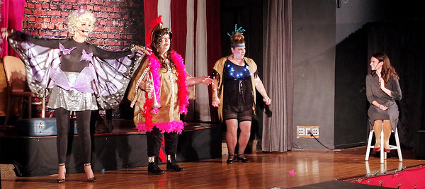 """Tessie Tura (Jill O'Malia), Mazeppa (Jane Cornelious) and Allison Cage) demonstrate their unique """"gimmicks"""" to Louise (Alaina Coplin) in the Alexandria Commons Theatre's production of """"Gypsy."""""""