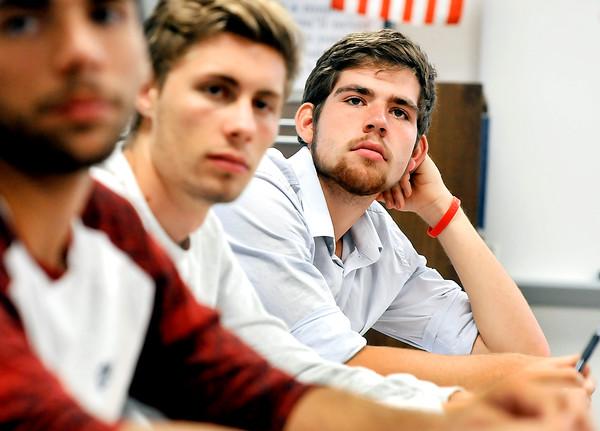 John P. Cleary   The Herald Bulletin <br /> James Brandon listens to Richard Ziuchkovski explain a math problem in his calculus class at Anderson High School Wednesday.  Brandon is a National Merit Scholarship semi-finalist.