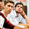 John P. Cleary | The Herald Bulletin <br /> James Brandon listens to Richard Ziuchkovski explain a math problem in his calculus class at Anderson High School Wednesday.  Brandon is a National Merit Scholarship semi-finalist.