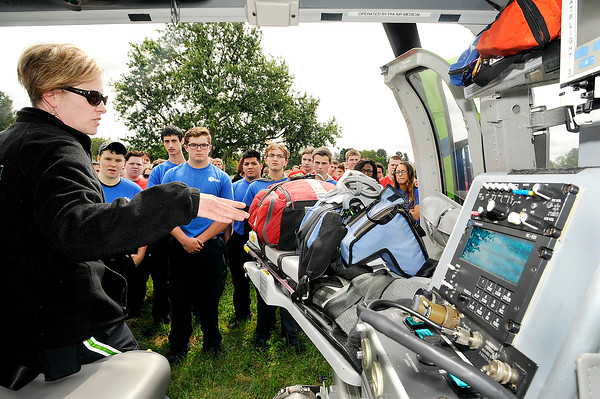 John P. Cleary | The Herald Bulletin<br /> Stat Flight medical helicopter flight nurse Jennifer Johnson explains some of the equipment the crew uses to a group of Anderson High School D26 Career Center EMT, Fire/Rescue, and Health Science students Monday as the helicopter flew into the school for the visit.