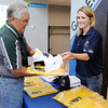 Don Knight | The Herald Bulletin<br /> Rachel Christenson gives Bill Hutton his Torchbearers uniform during training at the Visitors Bureau on Wednesday.