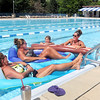 John P. Cleary | The Herald Bulletin<br /> Connie Sizemore, Patti West, Arabelle Johnson and Misty Johnson enjoy the sun, the water and the conversation as they relax at the Dolphin Club Friday.<br /> The swim club is celebrating their 50th anniversary this year.