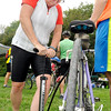 John P. Cleary | The Herald Bulletin<br /> Jill Oglesbee, of Gaston, pumps up her tires before heading out on a 25 mile bike ride from Canoe Country Saturday as part of Hoosier Environmental Council's 2nd annual Ride for the Mounds bike ride.