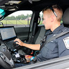 Don Knight | The Herald Bulletin<br /> Officer Garett Creason works on his laptop in his Chesterfield police cruiser on Wednesday. Creason grew up in the Chesterfield area and worked previously as a reserve officer for the department.