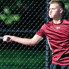 John P. Cleary | The Herald Bulletin <br /> Alexandria's #1 singles Matthew Hensley returns a forehand shot during his match with Frankton's Keegan Freestone Monday. Hensley won the three set match.