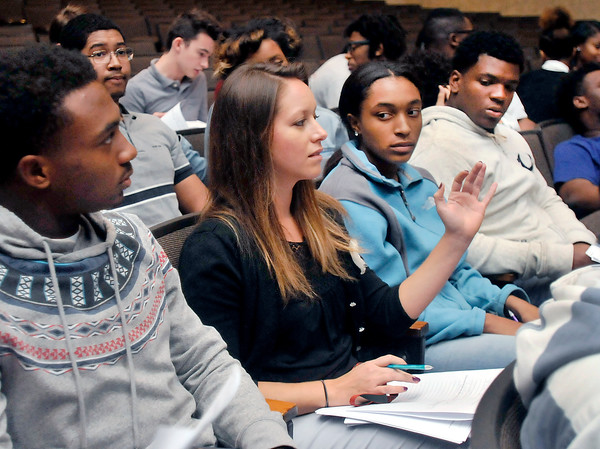 John P. Cleary | The Herald Bulletin<br /> Lawrence North High School debate class teacher Sylvania Hernandez engages her students about what they heard during the first gubernatorial debate held at the school.