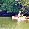John P. Cleary | The Herald Bulletin <br /> This kayaker slowly works his way back toward the boat ramp as he lets his fishing line trail behind him as he paddles along the banks of Shadyside Lake Tuesday afternoon.