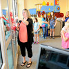 Don Knight | The Herald Bulletin<br /> Rheanna Reed cuts the ribbon to open a courtyard garden dedicated to the memory of her daughter Jillian Reed at Eastside Elementary on Thursday. September is Childhood Cancer Awareness Month.