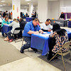John P. Cleary | The Herald Bulletin<br /> The table were full of people filling out job applications at the Hire Anderson Job Fair Wednesday.