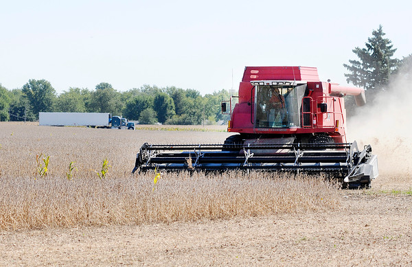 Don Knight   The Herald Bulletin file photo<br /> A combine works in a soybean field south of Erskine Elementary School in Anderson on Wednesday.