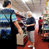 John P. Cleary | The Herald Bulletin <br /> Beverly Cox, center, owner of Cox Gift Shop in Alexandria, helps a customer during her clearance sale to close the store after 60 years in business.