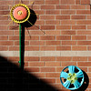 Don Knight | The Herald Bulletin<br /> Hub caps painted like flowers add color to the brick wall of a couryard garden dedicated in memory of former student Jillian Reed at Eastside Elementary on Thursday. Reed had an aggresive form of brain cancer and died on Nov. 7, 2015.