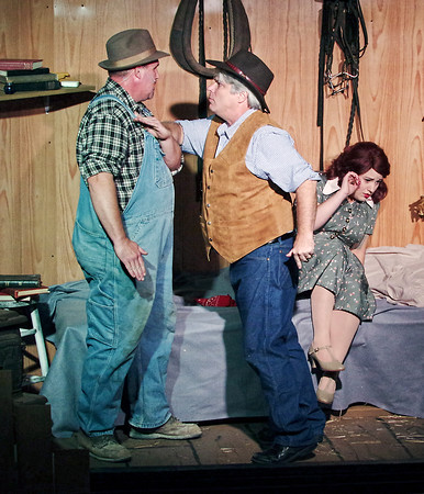 """Mark Maynard   for The Herald Bulletin<br /> The Boss (Dr. Jay L. Wile) shoves George (Andrew Persinger) aside as Curley's wife shields herself in """"Of Mice and Men"""" presented by Anderson's Mainstage Theatre."""