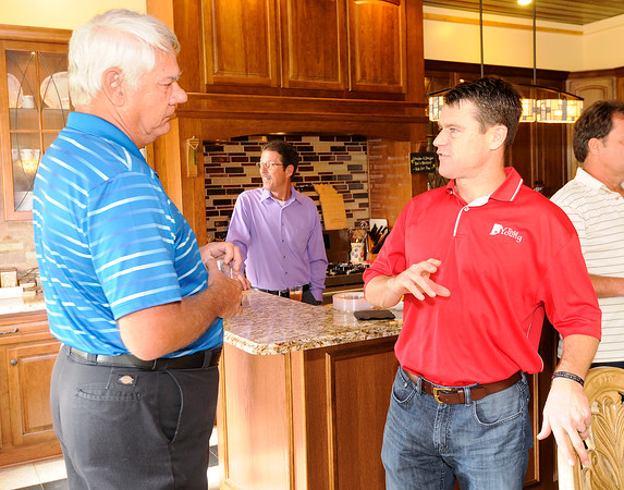 Don Knight | The Herald Bulletin<br /> David Sylwestrak talks to U.S. Senate candidate Todd Young during a GOP event at the home of Stephanie and Bryce Owens on Saturday.