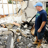 Don Knight | The Herald Bulletin<br /> Johnathon Stevens stands in what remains of his apartment that was damaged by a fire at Applecreek Apartments. Residents were allowed in to their apartments on Friday to salvage what they could.