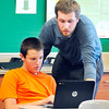 John P. Cleary | The Herald Bulletin<br /> Pendleton Middle School Social Studies teacher Matt Vosburgh assists 7th grader Evan McConnell with his question as he works on his social studies lesson on the computer as part of the schools 1:1 technology program.