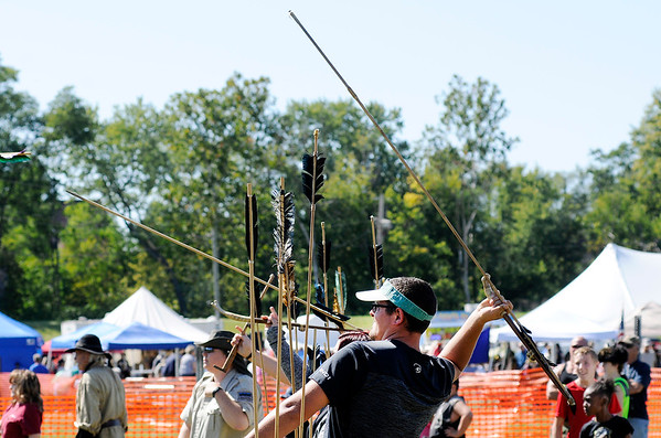 Don Knight | The Herald Bulletin<br /> Bryce Bates throws an Atlatl after some instruction from DNR Naturalist Kelly Morgan during the Andersontown Powwow on Saturday.