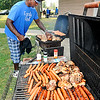 "John P. Cleary |  The Herald Bulletin<br /> Roosevelt Potts checks the grills as he cooks up a variety of food for the Labor Day gathering of about 200 people that are part of the Hester family Monday at Jackson Park for their ""Family First"" get together."