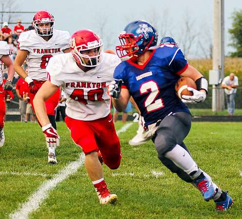 Chris Martin for The Herald Bulletin<br /> Jake Wilson runs the ball for Elwood Friday night at home against Frankton.