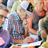 John P. Cleary |  The Herald Bulletin<br /> Jim Kline, of Kline Family Farms in Hartford City, studies the information being handed out during the seminar at the Moses Organic Field Day held at Oak Ridge Farms in Pendleton last week.