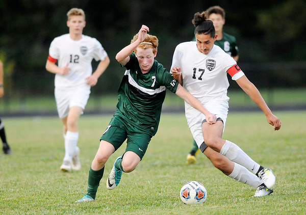 Don Knight | The Herald Bulletin<br /> Pendleton Heights' Brennan Jones and Anderson's Christian Contreras fight for control of the ball as the Indians hosted the Arabians on Wednesday.