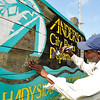 John P. Cleary |  The Herald Bulletin<br /> Anderson City Parks Department painter Gregory Campbell paints the background of the Shadyside Recreation Area sign located at Cross Street and Alexandria Pike Wednesday afternoon.