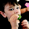 John P. Cleary |  The Herald Bulletin<br /> Tenth Street Elementary School first grader Jackson Hill takes a nibble of the lettuce grown in the classroom's hydroponics tower they  have in their classroom.