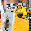 Don Knight | The Herald Bulletin<br /> Kara Pence looks for a book to read in English class at the Lapel High School Media Center on Friday.