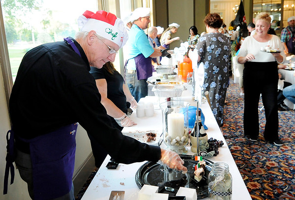 Don Knight | The Herald Bulletin<br /> David Renz serves up his Italian Love Cake during the Community Chefs fundraiser at the Anderson Country Club on Saturday. This was the fifth year for the event that benefits the Community Hospital Anderson Foundation.