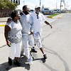 Don Knight | The Herald Bulletin<br /> Trondo Humphrey, middle, walks out of the Madison County Jail with his mother Ruth Miller and uncle Walter Williams on Friday after the Indiana Supreme Court overturned his murder conviction. Humphrey spent 21 years in prison.