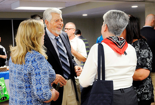 Don Knight | The Herald Bulletin<br /> Former Aspire CEO and President Richard DeHaven visits with Aspire employees after a dedication renaming the Aspire location at 2020 Brown Street the DeHaven Building in his honor on Wednesday.