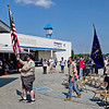 """Members of Boy Scout Troop 230 present the colors to open ceremonies supporting public safety workers during Sunday's """"Honor the Badge"""" event at the Mounds Mall."""