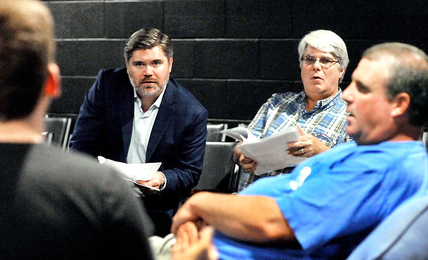 "John P. Cleary |  The Herald Bulletin<br /> Director David Coolidge, left, watches intently as his actors go through rehearsal of  ""Amazing Grace,"" a one-act play written by Jay Wile, seated next to Coolidge. Four original one-act plays will be featured Saturday at the Alley Theatre in Anderson."