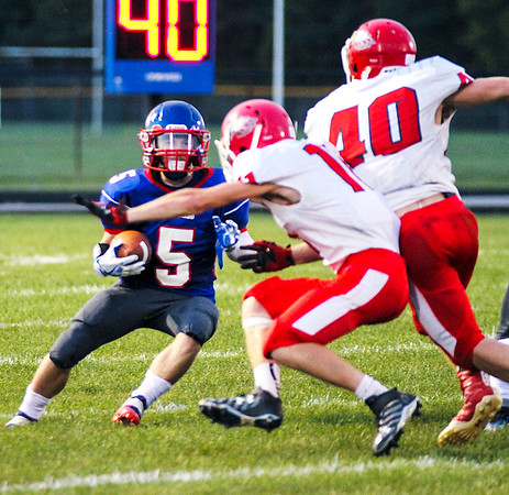 Chris Martin for The Herald Bulletin<br /> Elwood's Brayton Thomas runs the ball Friday night at home against Frankton.