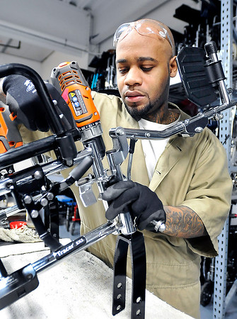 John P. Cleary |  The Herald Bulletin<br /> Richard Hawkins works on this wheelchair at his work station in the Pendleton Correctional Industrial Facility's wheelchair shop. Hawkins is one of the inmates that works in the Wheels for the World program.